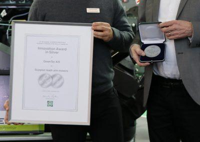 Urkunde & Medaille